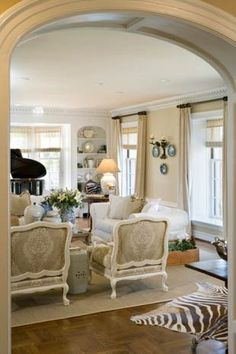 wish I could see into this room ~ arched doorway, baby grand, and zebra rug ~ what else is there?
