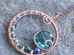 Copper+swirl+medallion+necklace+with+deep+blue+and+by+sparklegem,+$55.00