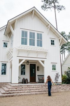 Lisa Furey Interiors designed this modern farmhouse cottage, a mini-compound built over time in Palmetto Bluff, Bluffton, South Carolina. White Farmhouse Exterior, White Exterior Houses, Farmhouse Style, Farmhouse Front, Cottage Farmhouse, Farmhouse Ideas, White Houses, Cottage Homes, Farmhouse Decor