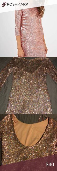 Topshop pink sequin body-con dress Color is pink! Worn once, perfect condition. The sleeves are 3/4 and the back has a scoop. I'm 5'4 and this dress is a little above knee length. Has a layer underneath so the sequin isn't itchy at all. Hand wash only! If you have any questions about this beautiful dress please let me know. Topshop Dresses Mini