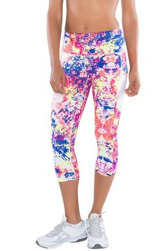 Moto Capri leggings in bright multicolor print with a high waist band which can be folded over and converted into low waist and side mesh pockets. In a high-quality Infi-Dry anti-bacterial fabric.  Moto Capri Leggings by TLF Apparel. Clothing - Activewear Florida