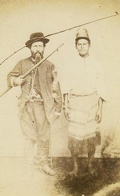 Brazilian official and an inprisioned Paraguaian soldier, circa 1865. Note that the soldier is barefoot, as most of the army from Paraguay during the war