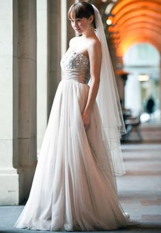 Gorgeous & romantic!! Description:A tulle A-line gown with draped bodice and beaded tulle bust. Colour: gold.    Contact Mariana Hardwick