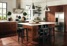 Traditional Kitchen with Hardwood floors, Marble.com White Carrara Marble, European Cabinets, Flush, Pendant light, L-shaped