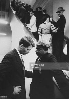 News Photo : Robert F. Kennedy talking with Sidney Clark .