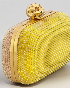 alexander McQueen yellow clutch with 'pearls' embedded with skull detail