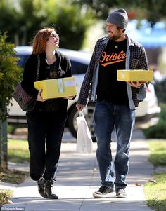 Almost time for pumpkin pie! Alyson Hannigan and her husband Alexis Denisof looked thrille...