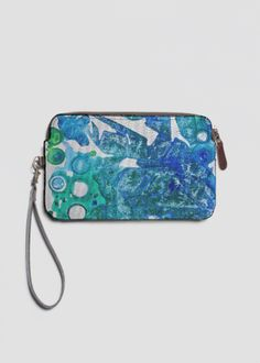 Accent your outfit with our chic custom printed Leather Statement Clutch featuring a top zip closure and removable wristlet strap. by artist Alicia Noelle Jones @anoellejay @shopvida