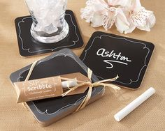 """Sip and Scribble"" Chalkboard Coasters. Chalk this favor up to pure fun! Don't be surprised if your guests break out their favors on the table and leave you wishes for happiness, and don't be surprised if they're thrilled to take them home and customize the coasters for every occasion. They'll never get ""chalk bored!"" Features and facts:  Each favor contains four real chalkboard coasters, black with delicate, white scroll accent, ready to write on with a piece of chalk Coaster..."