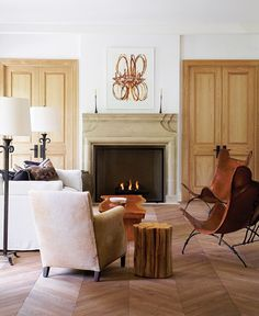 Photo Gallery: 2011 Princess Margaret Showhome  Beautiful Fireplace Design    The view from the library showcases the warm, neutral great room.    The limestone mantel and hearth stone were custom-made by Tartaruga Design. On the mantel, artwork by Daniel Schneider is flanked by handwrought iron candlesticks from Hollace Cluny.