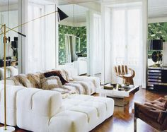 I don't necessarily like this all together, but there is lots to love. Coffee table, hand chair, wallpaper and lamp.