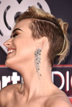 Katy Perry Photos Photos - Musician Katy Perry, hair and earirng details, attends the 2017 iHeartRadio Music Awards which broadcast live on Turner's TBS, TNT, and truTV at The Forum on March 5, 2017 in Inglewood, California. - 2017 iHeartRadio Music Awards - Arrivals
