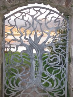 The gate in the walled garden at Inverewe Garden Wester Ross. Beautiful gate opening on to a peaceful shoreline.