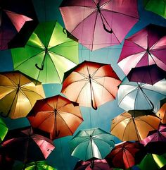 """Photographer Patrícia Almeida recently shot these great photos of this umbrella installation. As she writes, """"In July, in Águeda (a Portuguese town), some streets are decorated with colorful umbrellas. I felt like a kid, amazed by all that color! Umbrella Art, Under My Umbrella, Umbrella Street, Instalation Art, Colorful Umbrellas, Paper Umbrellas, Colorful Socks, Foto Art, Art Plastique"""