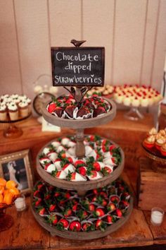 Chocolate dipped strawberries weclome guest at this wedding dessert table. Dessert Bar Wedding, Wedding Desserts, Wedding Dessert Tables, Easy Wedding Cakes, Dessert Display Table, Easy Wedding Food, Cheap Wedding Ideas, Wedding Reception Ideas, Wedding Buffet Food