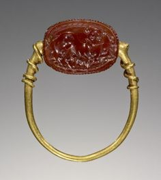 Unknown, Scarab, Etruscan, 4th century B.C., Carnelian, gold - See more at: http://search.getty.edu/gateway/search?q=&cat=type&types=%22Jewelry%22&rows=50&srt=&dir=s&dsp=0&img=0&pg=7#sthash.b4gJvdvN.dpuf