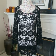 Beautiful Crochet Top This gorgeous piece needs a new home! Can be worn as a bathing suit cover up or a top with cami under  as seen in the pic. Does not have tag I would say it fits S-M. Tops Tunics