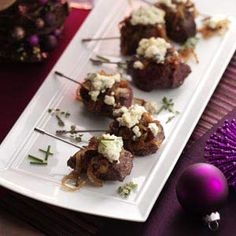 Beef Tenderloin Lollipops Recipe -Bite-sized beef cubes are easy to pop in your mouth as you mingle at parties. The sweet caramelized onion and salty blue cheese add unforgettable taste.