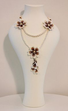 An ornate flower trio necklace with freshwater pearls. Three sparkling autumn flowers embroidered with japanese seed beads. Each flower measures 2 inches in diameter. A stylish necklace suited for any special occasion or event. Diy Necklace Bracelet, Floral Necklace, Beaded Necklace, Pearl Necklace, Mother Necklace, Collar Necklace, Crochet Necklace, Bead Jewellery, Jewelry Making Beads