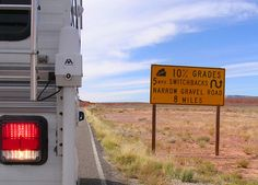 Warning signs for the Moki Dugway, No problem with a #truckcamper! http://www.truckcampermagazine.com/news/truck-camper-magazine-the-never-before-told-story/