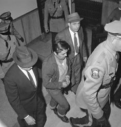 Perry Edward Smith is led by police officers into the courthouse at Garden City, Kan., Jan. 6, 1960. Smith was arrested in Las Vegas and charged with first degree murder in the slaying of four members of the Herbert Clutter family at their farm house in Holcomb, Kan. (AP Photo/William Straeter) Edward Smith, In Cold Blood, Famous Murders, True Crime Books, Serial Killers, Emporia Kansas, Clutter, Farm House, Beading Projects