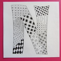 Zentangle letter N; Downtown Art Project Zentangle 10 inch Wood Tile by Nancy Domnauer