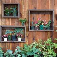 Darling idea to break up the fence row.  You could do this indoors as well...maybe fresh herbs in the kitchen???  or any potted flowers in bedrooms/bathrooms.