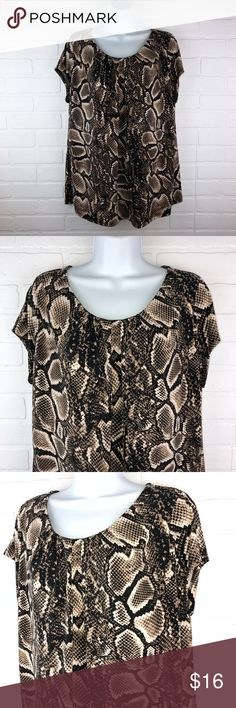 Worthington 1X Tan Black Snake Print Knit Blouse Worthington 1X Tan Black Snake Print Knit Blouse  95% polyester, 5% spandex made in Vietnam armpit to armpit:  23.5 inches length:  25 inches short sleeve  Bundle 2 or more items and save an additional 10%  Thank you for shopping my closet!  Stock: P2 Worthington Tops Blouses