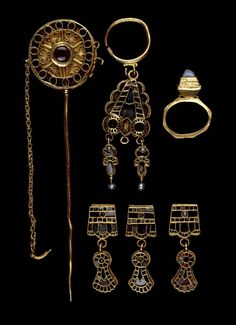 Gold earring: small wire hoop; large sub-triangular pendant with lobed edge and two empty circular bosses at base angles; suspension loops for three elongated sub-pendants (central one missing), each in form of a winged insect with a pearl at the end; all-over cloisonné garnet rhombs, discs and segments (mostly missing), green glass and pearl inlays; beaded wire border.       Ostrogothic 5thC(late)-6thC(early)