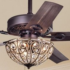 Add a touch of splendor to your living or dining room with this elegant crystal ceiling fan by Warehouse of Tiffany. An ornate crystal bowl shade provides luxurious light with or without the fan. Ceiling fan with crystal chandelier. Ceiling Fan Chandelier, Bronze Ceiling Fan, Bronze Chandelier, Ceiling Lights, Ceiling Fans, Chandeliers, Ceiling Ideas, French Chandelier, Ceiling Fan With Remote