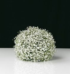 Fresh? Use daisies. It looks extremely elegant made of roses and it's perfect with chrysanthemums. Here baby's breath, or gypsophila, gives an ethereal edge.   To make it, cover a ball of oasis in short-stemmed flowers, pushing the stalks in firmly as you go. It makes a gorgeous decoration for a special-occasion table setting but would look equally good sitting on a hall or coffee table. You could even hang it.