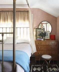 The bedspread and linens in this bedroom are by Restoration Hardware, and the chest of drawers is from the 1940s.