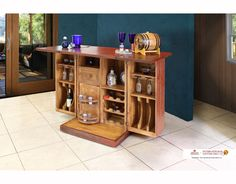 MODEL ITEM DIMENSIONS IFD966BARMultifunctional Island Bar28-1/4 x 25-1/2 x 39  FEATURES 1. 100% Solid pine. 2. Hand rubbed red antique finish. 3. Great storage piece includes: horizontal wine rack for 9 wine bottles, vertical bottle compartments holds 6 bottles; rack for 8-12 glass cups, swivel rack holds 6 shot glasses, 4 shelves, 1 drawer, and ample unfold able working area. All in about 2 sq ft ! (when closed).