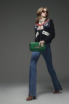Fendi Prefall 2015. Boxy turtleneck graphic sweater, blue jeans, bold clutch and boots. Perfect casual.