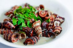 Snails-stir-fried-with-coconut-cream.  More Vietnamese Street Food at  http://danangfoodie.com/category/blog/  #ochut #suckingsnails #danangfood #streetfood #danangcuisine #danangfoodie #foodietour