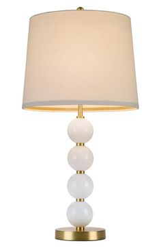"Need this Art Deco lamp from the new Cupcakes and Cashmere home collection at Nordstrom! A lovely natural shade tops a playful stacked ball table lamp with a slender goldtone pole. 28"" height; 14"" shade diameter."