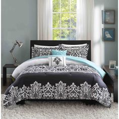 For a modern update to your bedroom, the Hazel Comforter Set is perfect for you. A bold black damask is printed on a white background for the perfect amount of drama. A pop of teal is featured on the solid reverse for a little bit of fun.