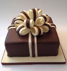 www.lifeissweetcakes.co.uk A present cake - one of the first I made with chocolate sponge and chocolate mouse and sauce filling #birthdaycake