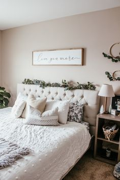 Gorgeous Anthropologie inspired Christmas bedroom with eucalyptus garland white tufted headboard bohemian throw pillows eucalyptus wooden hoop wreaths white pom pom coverlet and a fiddle leaf fig. Loving this gorgeous boho farmhouse bedroom. Cozy Bedroom, Home Decor Bedroom, Bedroom Wall, Bedroom Ideas, Bedroom Designs, Master Bedroom, Bedroom Romantic, White Bedroom Furniture, Large Bedroom