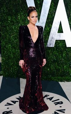 J-Lo looking like a bit of a one-trick pony with yet another daring plunging neckline.