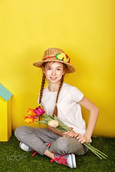 Teen girl in straw hat holding spring flowers. by Elena Vagengeim on 500px