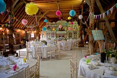Pretty paper pompoms at Preston Court. Photos by @CCandyWeddings