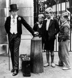 A Formally Uniformed Eton Schoolboy Is Watched by Local Boys at the Eton v. Harrow Cricket Match at Lord's in London, U.K., in 1937. Now that is posh!