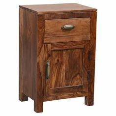"Crafted of beautiful sheesham wood, this 1-door accent table offers 1 drawer for stowing stationery, magazines, or remote controls.    Product: CabinetConstruction Material: Sheesham woodColor: Medium brownFeatures:  One drawerOne doorDimensions: 28"" H x 18"" W x 13"" D Cleaning and Care: Wipe clean with dry cloth. Do not clean with harsh chemicals."