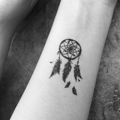 I'm obsessed with dreamcatcher and feather tattoos