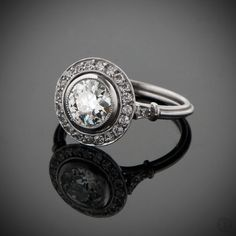 OMG! An Epic Vintage Diamond Engagement Ring surrounded by a halo of diamonds, and set in platinum. What a stunner!