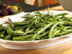 Garlicky Green Beans: HUGE hit for festive dinners or just any time. Be sure to blanch the beans after you boil them as it helps keep them cooked but crisp. Don't skimp out on the butter for margarine - this is the one time where you want to exaggerate all the rich savoury flavours. Rating: 5/5