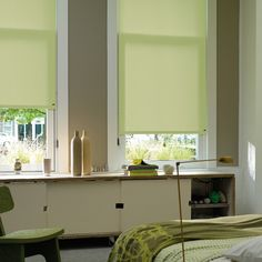This lovely spring green Luxaflex® Roller Blind adds a light, fresh touch at the bedroom window.  #luxaflex#roller blinds #home decor #bedroom