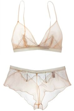 ZsaZsa Bellagio  |  This lovely lingerie would be so much more exquisite if cut with less seams esp the bottom piece; could be two side seams and hip only.
