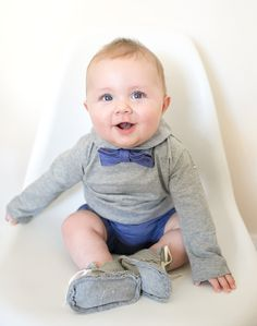 Description Indigo baby bow tie made from 100% organic cotton. Fastens with velcro on the back to make it super easy to take the bow tie on and off a wiggly babe. Made exclusively for Noble Carriage b